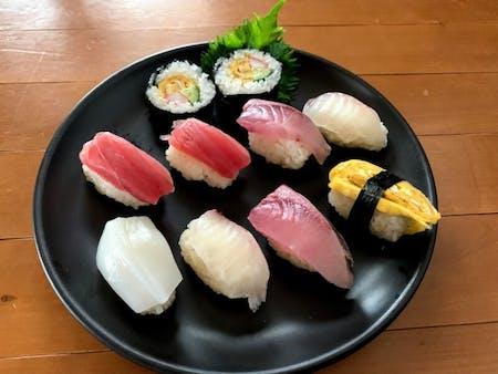Sushi lesson, nigiri-sushi and rolled sushi with Japanese dashi-soup