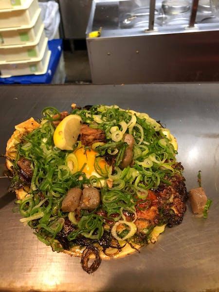 Homemade Okonomiyaki, Takoyaki, Negiyaki which is made by  green onions, Gyoza.