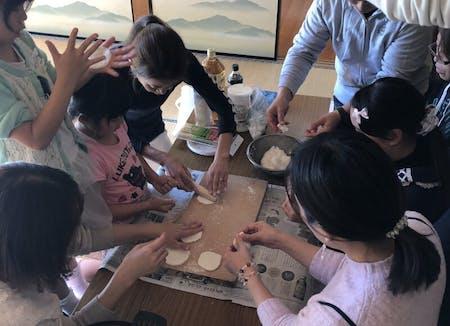 Japanese GYOZA,Shiraae,Clear Soup,and Organic Rice.